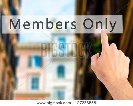 Members Only - Hand Pressing A Button On Blurred Background Concept On Visual Screen.