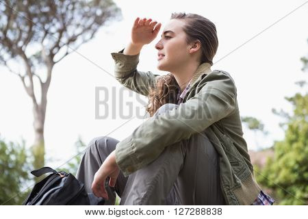 Woman observing something in the countryside