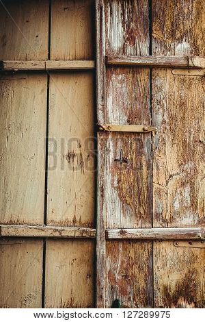 old wooden window with closed shutters. old wooden window with closed shutters