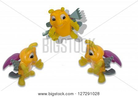 three amicable toy bee close to each other hugs