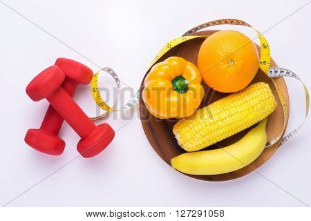 Dumbells, tape measure, healthy food and fruit for copy space. Fitness and health. Isolated on white background