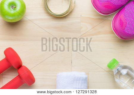 Dumbbells, sport shoes, water, apples and notes paper on white background. Healthy life and healthy food concept
