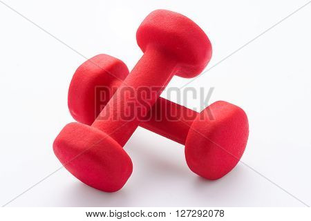 Red dumbbells  for using in fitness, concept for slimming and healthy lifestyle.
