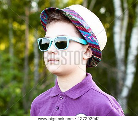 Boy with glasses and hat summer day in the woods, outdoors resting one concept confident little man fashion style concept idea, shirt