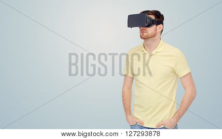 3d technology, virtual reality, entertainment and people concept - young man with virtual reality headset or 3d glasses over gray background
