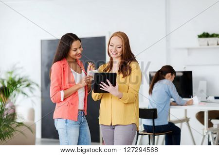 business, office, technology and startup concept - happy creative team with table pc in office