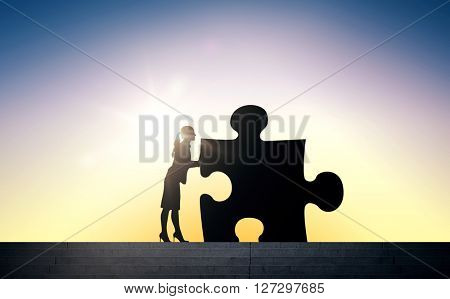 business, strategy, startup, development and people concept - silhouette of woman moving puzzle piece over sun light background