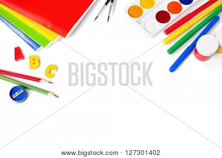 School equipment with pencils, brushes and  paints  isolated on white. Back to school concept. School stationery