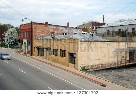 JOLIET, ILLINOIS / UNITED STATES - APRIL 19, 2015: A vacant building sits abandoned along Jefferson Street near downtown Joliet.