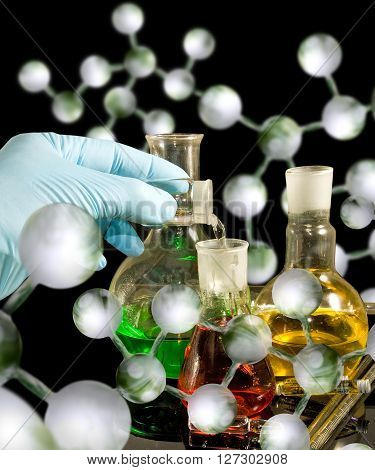 Image of different glassware and male hand in a glove close-up