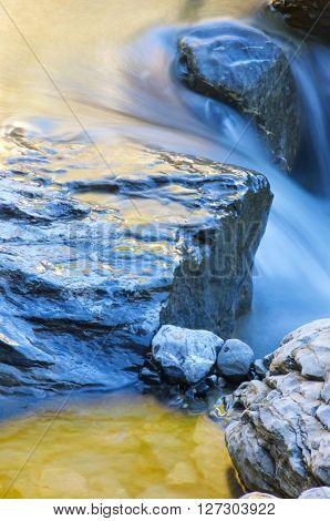 Colorful mountain creek in the Pyrenees, Pineta Valley, Aragon, Spain.