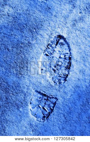 Footprint in the snow winter time treking hiking