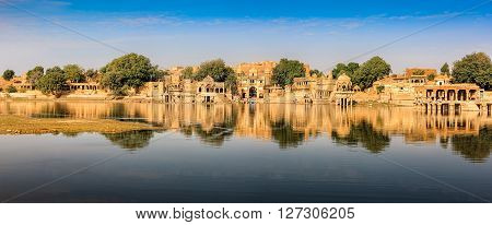 Gadi Sagar (Gadisar) Lake is one of the most important tourist attractions in Jaisalmer Rajasthan North India. Artistically carved temples and shrines around The Lake Gadisar Jaisalmer.
