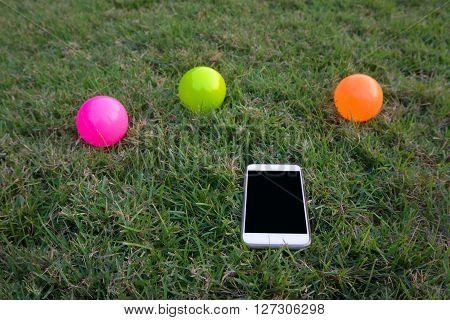 White Smartphone On Green Grass Background