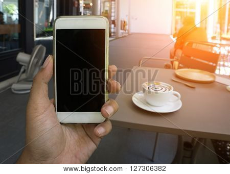 Man's Hand Shows Mobile Smartphone In Vertical Position