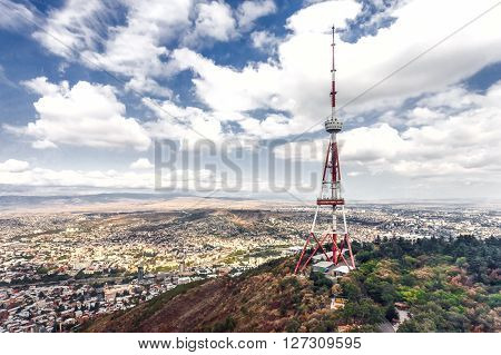 Georgia Tbilisi TV broadcasting tower with the city behind it