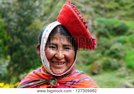 CUSCO PERU - APRIL 05 2012: Portrait of the woman from the Sacred Valley in the Cusco area from traditional headgear in transit to the local market in South America in April 05 2012