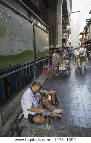 BANGKOK THAILAND - mar 5 : singing beggar at siam square shopping street on march 5 2016 thailand. Siam square is famous shopping place of Bangkok