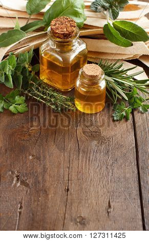Wholegrain artisan pasta olive oil and herbs on old wooden table