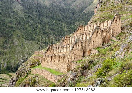 The picture presents Pinkulluna Inca ruins in the Secret Valley in the vicinity of ruins Ollantaytambo incan fortress