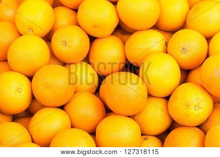 Background from fresh oranges for sale at a market
