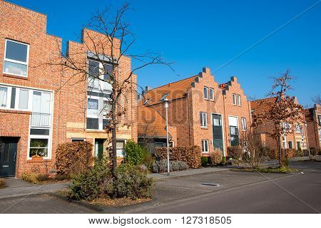 Modern neighborhood with red brick houses in Berlin, Germany