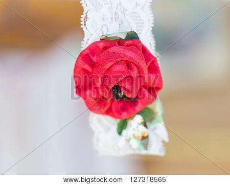 Beautiful handmade textile brooch from artificial flowers. Macro shot.