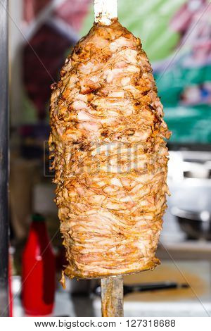 Chicken doner kebab on the metal skewer. Photo can be used as a whole background.