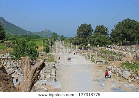 EPHESUS, TURKEY - APRIL 30, 2012: Tourists in Ephesus, Turkey. Ephesus was an ancient Greek city on the coast of Ionia, three kilometres southwest of present-day Selcuk in zmir Province, Turkey