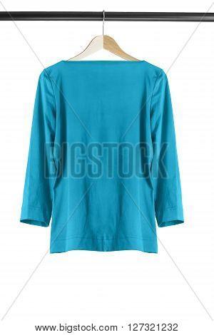 Blue silk blouse on clothes rack isolated over white
