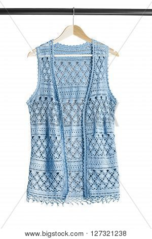 Blue crocheted vest on clothes rack isolated over white