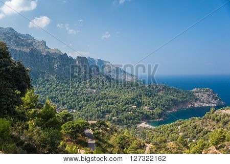 Panoramic view of Cala Tuent and the Mediterranean Sea on a sunny day.