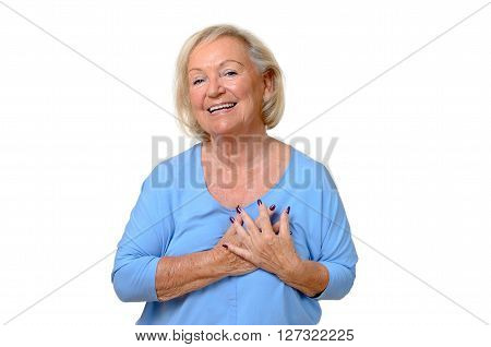 Elderly Woman Holding Her Hands To Her Heart