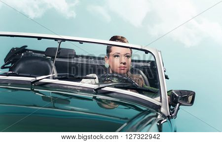Vintage 1960S Woman Driving A Convertible Car.