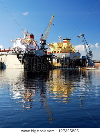 ship are being fixed and painted at the shipyard docks