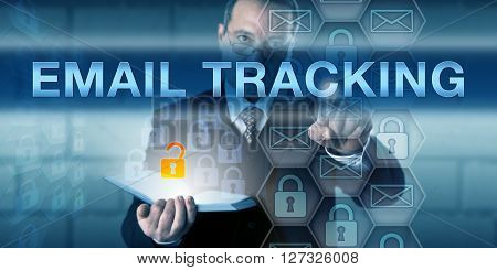 Management consultant is pressing EMAIL TRACKING on an interactive touch screen interface. Business metaphor and information technology concept for monitoring email delivery.
