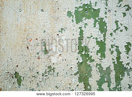 Abstract grunge background. Peeling green paint. Weathered peeling paint texture.