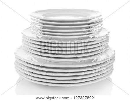 Stacked white dishes isolated on white