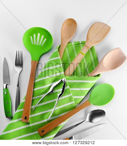 Set of kitchen tools with green napkin, isolated on white