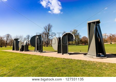 WAKEFIELD, YORKSHIRE, UK - APRIL 19: Promenade, the sculpture created by Sir Anthony Caro in 1966 for the Tuileries Gardens in Paris and exhibited permanently at the Yorkshire Sculpture Park. April 19, 2016 in West Bretton, UK.