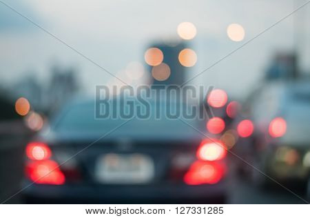 Motion blur of car on the road with abstract light bokeh in the evening background