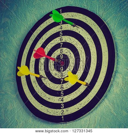 a dartboard with arrow in the center