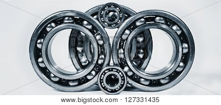 ball-bearings, gears in metal blue toning, set against a light background
