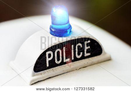an artificial toy of police siren closeup