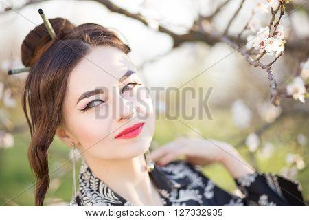 Beautiful Young Caucasian Woman Near Blooming Tree