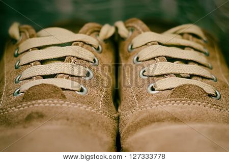a pair of a brown trendy sneakers