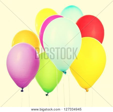 Colorful balloons isolated on white, clothe-up. Retro style