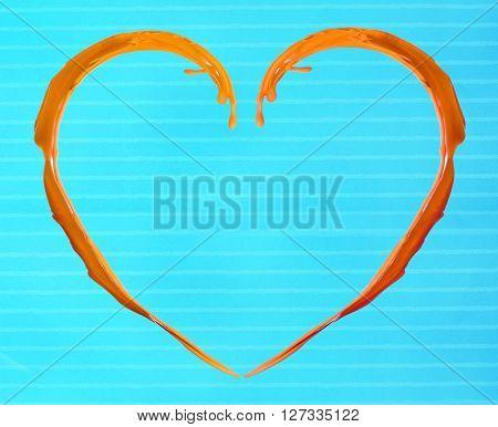 Orange heart made of paint splash on blue background
