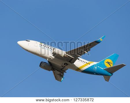 Moscow - August 20 2015: A passenger plane Boeing A319 Ukraine International Airlines Airlines flies to Domodedovo airport and clear sky August 20 2015 Moscow Russia