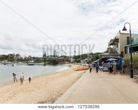 Sydney - March 1 2016: Sydney beach promenade and people walk and relax by the sea water Sydney Harbour March 1 2016 Sydney Australia
